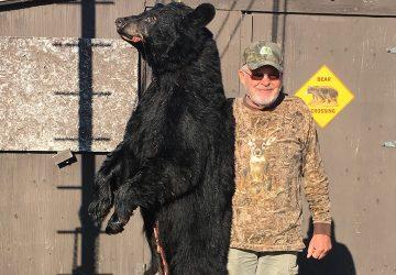 Man Holding Hunted Bear