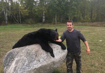 Man With Hunted Black Bear