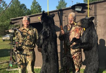 Two Hunters With Two Bears