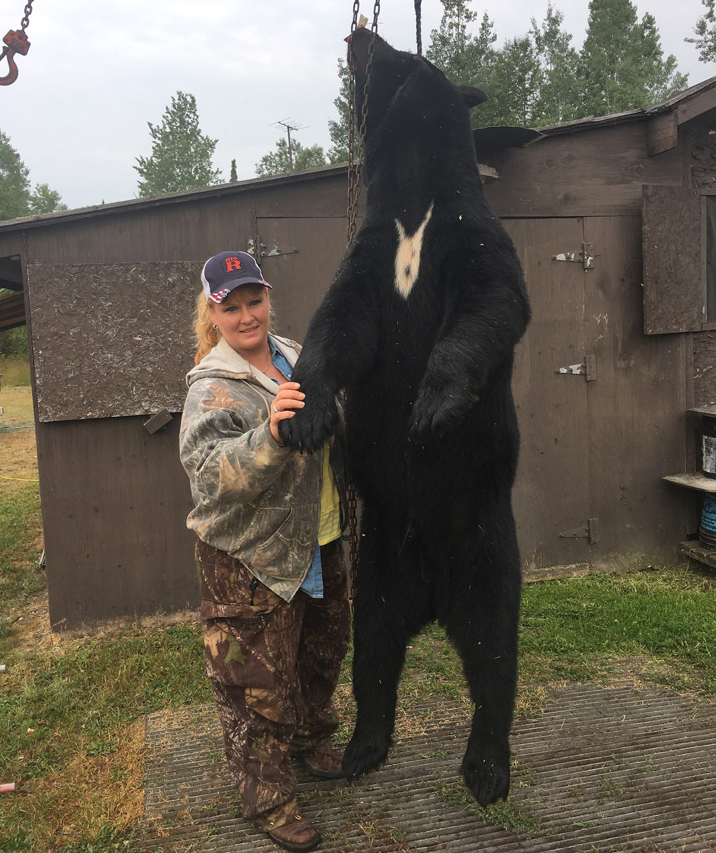 Woman With Hunted Black Bear
